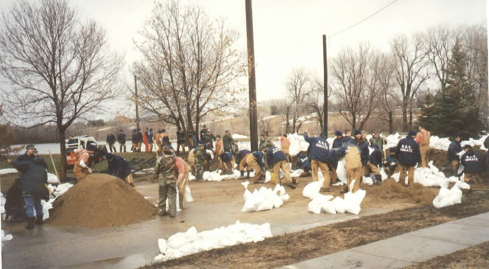 Inmates help sandbag following flooding in Watertown.
