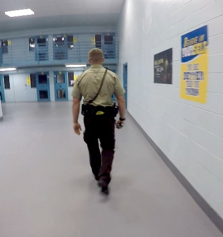 An officer makes rounds in a Restrictive Housing cellblock.