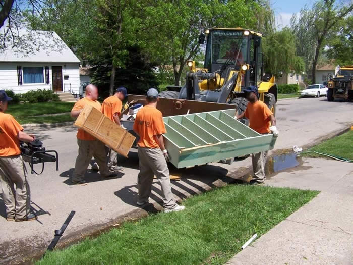 Inmates assist the City of Aberdeen with cleaning up following a 2007 flood.