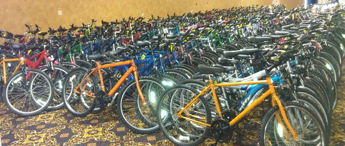 Refurbished bicycles are distributed at the annual Law Enforcement Game Feed in Sioux Falls