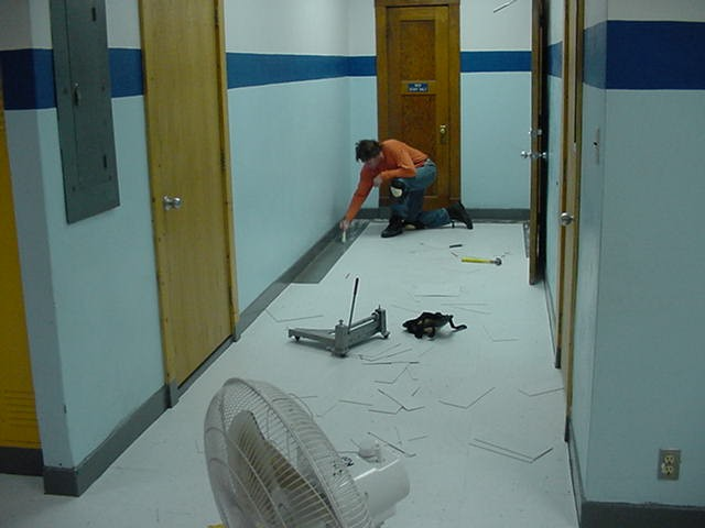 Inmate laying tile in Hot Springs school.