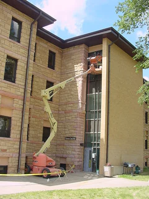 Inmate works on tuckpointing a building at BHSU.