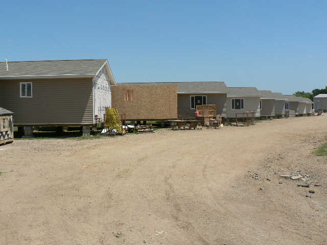 Inmates constructing houses at Mike Durfee State Prison.