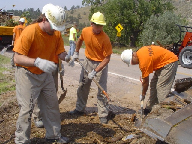 Inmates assist with flooding clean-up in Hermosa.